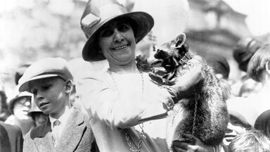 first lady grace coolidge holds rebecca raccoon