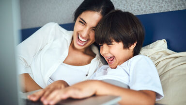 Mother and son laughing at parody