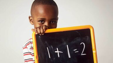 young boy using semantic memory for math problem