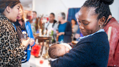 Politician holding baby at fundraiser