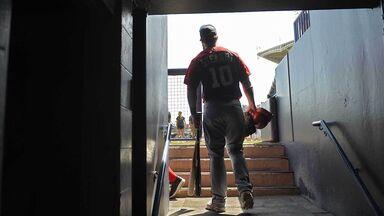 baseball player entering field through tunnel