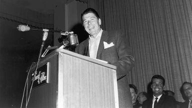 Ronald Reagan with James Garner laughing behind him