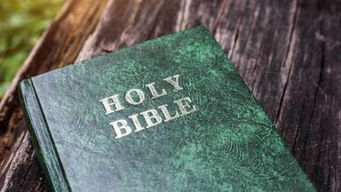 holy bible on a wood table