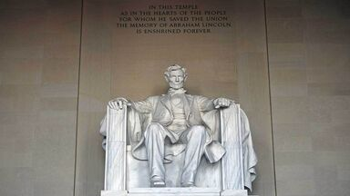 Lincoln memorial with words inscribed above