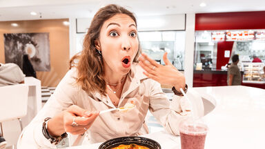 woman having spicy food reaction of burning mouth
