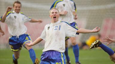 soccer players celebrating score goal