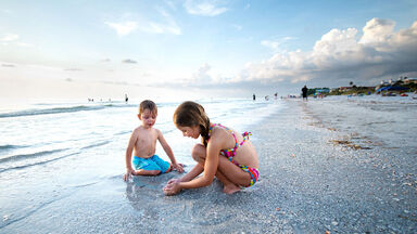 kids playing in sand on Florida beach