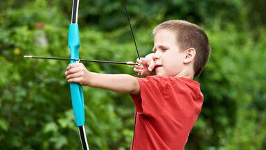 Boy archer with bow and arrow