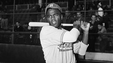 Jackie Robinson swinging bat in 1947