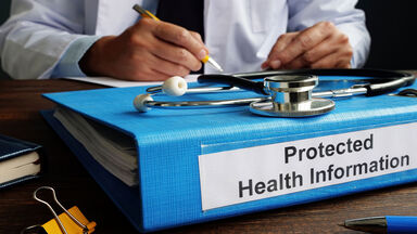 doctor with notebook labeled protected health information