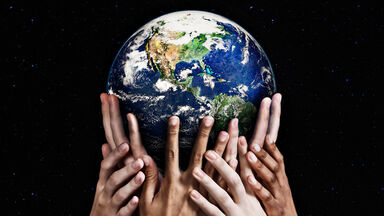 hands holding up planet