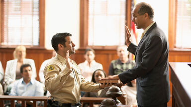 swearing in a witness in courtroom
