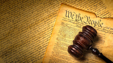 US Constitution with gavel and We the People