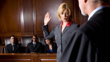 woman taking oath in courtroom