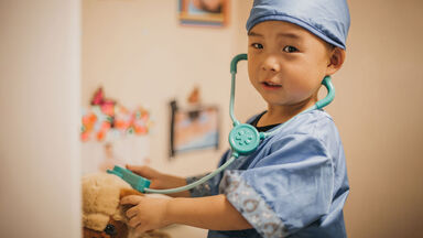 observational learning toddler boy playing doctor