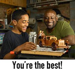 appreciation: father admires son's wooden car
