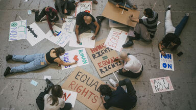Social justice topics written on signs