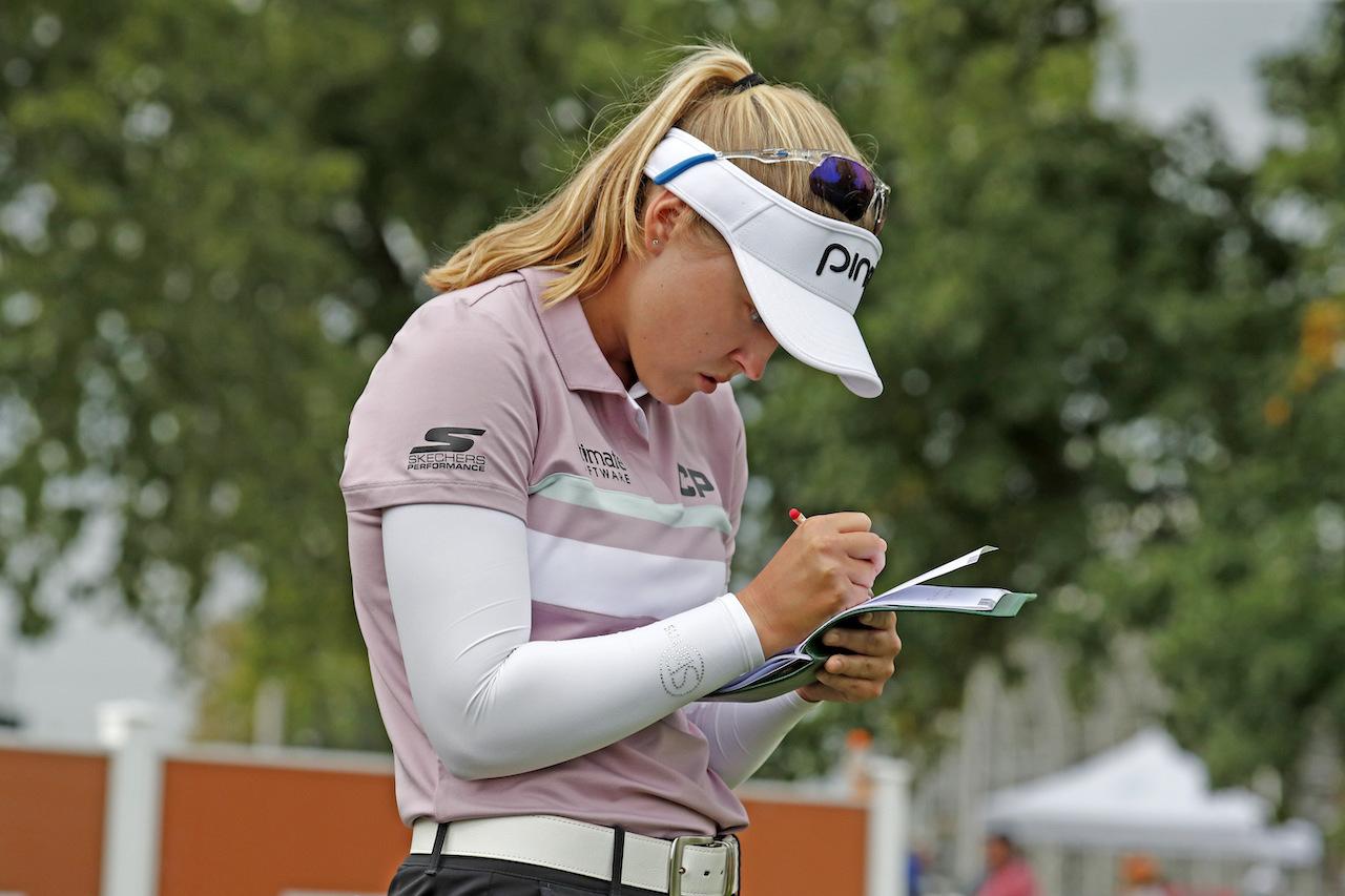Golfer filling out scorecard