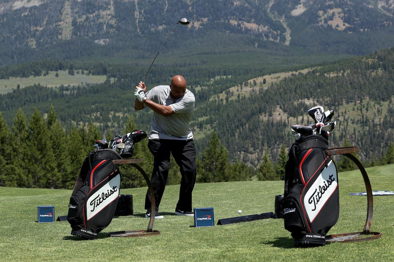 Charles Barkley swings on the driving range